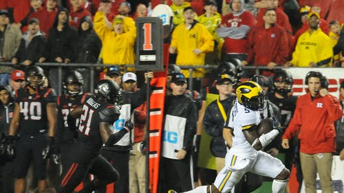 Michigan junior Jabrill Peppers beats former Wolverine and current Rutgers junior safety Ross Douglass on a 64-yard run in the first quarter of Rutgers' 78-0 loss to the No. 4 Wolverines Saturday night. – Photo by Dimitri Rodriguez