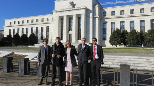 The team presented topics such as inflation, unemployment and output in the boardroom at the Federal Reserve. They prepared by constantly reading economics and financial news, academic research and speeches from Federal Reserve officials.