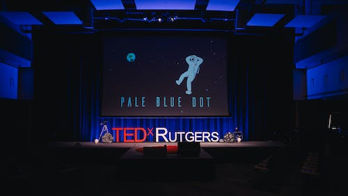 """The theme for this year's TEDxRutgers was """"Pale Blue Dot"""", which is a reference to a photograph taken by the space probe Voyager 1, which showed Planet Earth as a small speck. The theme aims to remind people to take a step back and look at the larger picture. – Photo by Thomas Boniello"""