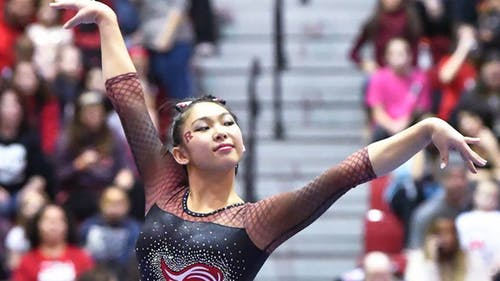 Co-captain senior Belle Huang has competed in 38 meets on the Banks. – Photo by RU Gymnastics / Facebook