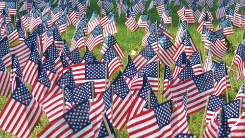 Three-thousand mini United States flags were arranged to look like the Pentagon at the 9/11 Never Forget Memorial held yesterday at the Voorhees Mall. – Photo by Daphne Alva