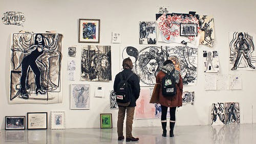 """Students attend """"Catch and Release"""" at the Mason Gross Galleries at  Civic Square, an exhibit showcasing the artwork of students pursuing  Master of Fine Arts degrees."""