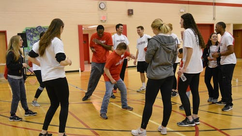 """On Sunday, hundreds of student volunteers and participants celebrated """"Special Friends Day"""" in the Cook/Douglass Recreation Center. The event gave people with mental disabilities a chance to partake in games and activities alongside Rutgers students. – Photo by Casey Ambrosio"""