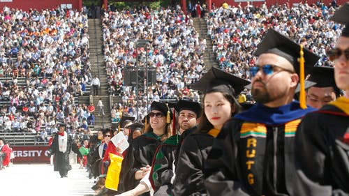 """Approximately 6,500 graduates of the Rutgers Class of 2019 sat in HighPoint.com Stadium to hear keynote speakers Jason and Devin McCourty speak about how to """"redefine success."""" – Photo by Dustin Niles"""