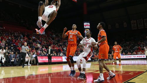 Junior forward Deshawn Freeman slams home an alley-oop from junior guard Nigel Johnson in the second half of Rutgers' 72-58 win over Morgan State Saturday night. The Knights' captain had a team-high 22 points and 12 rebounds for his fifth double-double in eight games. – Photo by Dimitri Rodriguez