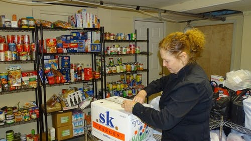 At a New Brunswick food pantry, rapidly declining attendance has become a source of concern for organizers. In the last few months alone, more than 50 families suddenly stopped showing up. – Photo by Camilo Montoya-Galvez