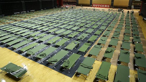 About 2,000 cots were set up for students in the recreation centers to sleep in overnight. Executive Vice President for Strategic Planning and Operations Antonio Calcado said this number is based on previous experiences evacuating students from the two campuses. There are roughly 3,200 students being evacuated in total. – Photo by Dimitri Rodriguez
