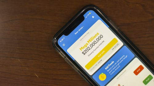 The application, called Jackpocket, features the Mega Millions, New York Lotto and Powerball lotteries and users can participate in different pools. – Photo by Kelly Carmack