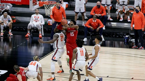 Junior center Myles Johnson and sophomore guard Paul Mulcahy combined for ten fouls, with Mulcahy being called for a technical foul.  – Photo by Kelly Carmack / Photo Editor