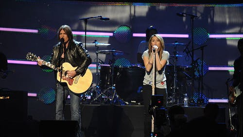 """Miley Cyrus and her father, Billy Ray Cyrus, starred in the hit show """"Hannah Montana."""" The two played characters similar to themselves off-screen. – Photo by Wikimedia"""