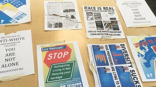 A student found the above posters on the ravine bridge on Douglass campus last November. He brought them to the Public Safety Building. – Photo by Courtesy of an anonymous source