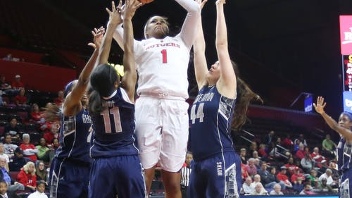 Senior center Rachel Hollivay muscles her way through three defenders to finish and score two of her game-high 22 points in Rutgers' 57-55 win over Georgetown in the first round of the WNIT. – Photo by Photo by Edwin Gano | and Edwin Gano The Daily Targum