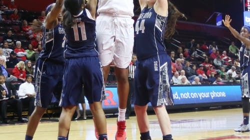 Senior center Rachel Hollivay muscles her way through three defenders to finish and score two of her game-high 22 points in Rutgers' 57-55 win over Georgetown in the first round of the WNIT. – Photo by Photo by Edwin Gano   and Edwin Gano The Daily Targum