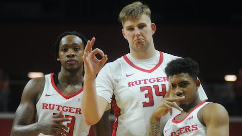 (From left to right) Junior forward Deshawn Freeman and graduate transfer C.J. Gettys, a pair of transfers who formed a friendship whonicknames themselves #GhostGang, pose for a photo with sophomore guard Corey Sanders following Rutgers 72-61 win over Morgan State Saturday. – Photo by Dimitri Rodriguez
