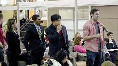 <b>Students queue to speak at the Rutgers University Student Assembly's meeting the evening of Feb. 19 at the Student Activities Center on the College Avenue campus. </b>AARON SAVAGE