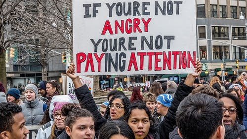 """When men say """"not all men,"""" they're inadvertently including themselves into the survivors's narrative, when they should, instead, take the time to offer support or call out predatory behavior.  – Photo by Fred Murphy / Codepink.com"""