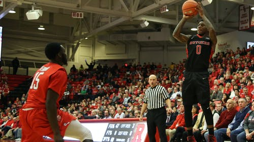Junior guard Nigel Johnson shoots a three in the second half of Rutgers 71-66 win over Stony Brook at the Island Federal Credit Union Arena Saturday night. Johnson led the Knights with a career-high 21 points. – Photo by Photo by Dimitri Rodriguez | and Dimitri Rodriguez The Daily Targum