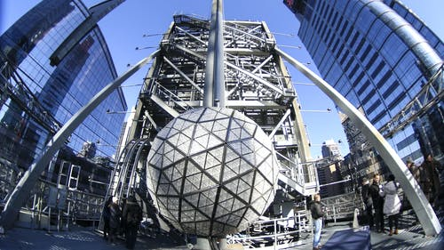 """The New Year's Eve Ball sits atop One Times Square covered in 2,688 Waterford Crystal triangles featuring this year's """"Gift of Serenity"""" design. At 6 p.m. on Dec. 31, the 11,875-pound ball will be raised to the top of the 130-foot flagpole and at 11:59 p.m. begins its 60 second descent. – Photo by Dimitri Rodriguez"""