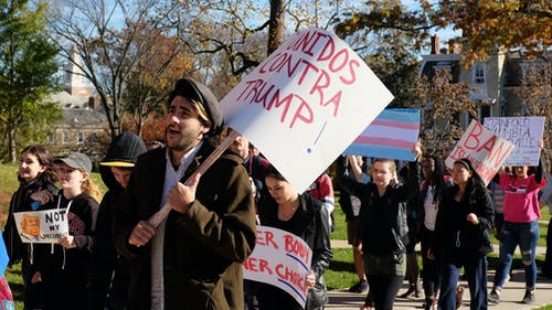 More than 100 students marched down College Avenue and George Street to show their support for minorities and students in the LGBT community after Republican Donald Trump was elected as the next United States President last Tuesday. – Photo by Jason Ye