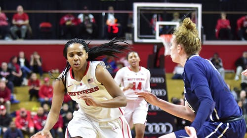 Sophomore guard Tyler Scaife slides past a defender on Sunday against Penn State at the RAC. Scaife complemeted Copper's game-high 25 points with 21 of her own in the win. – Photo by Tian Li
