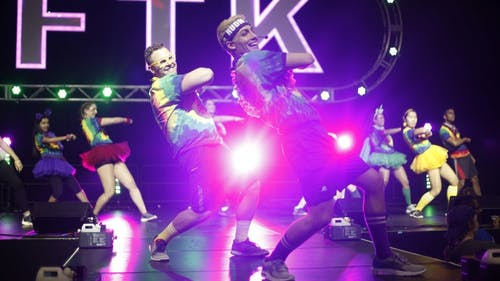 Every hour, members from the dance marathon committee would get on stage to teach the audience the choreography to a line dance, which includes a variety of songs from different time periods and genres. – Photo by Garrett Steffe
