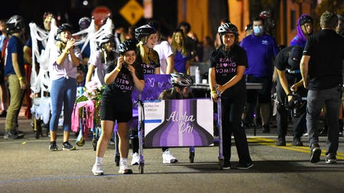 In this year's homecoming bed races, teams of four members from various campus organizations raced each other down Sicard Street in support of children from Roosevelt Elementary School in New Brunswick. – Photo by Samantha Cheng