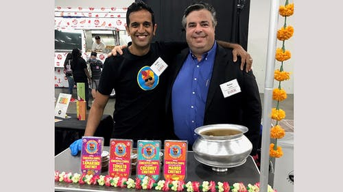 Nolan Lewin, acting executive director and director of operations of the Food Innovation Center (FIC) standing with Anshu Dua, co-founder of the Chaat Company. – Photo by Rutgers.edu