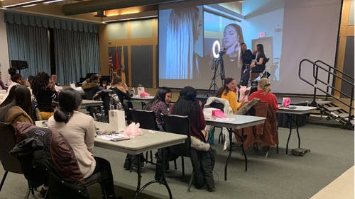 Professional makeup artist Christina Vergara made her way to Busch Student Center to demonstrate some makeup tips and tricks, recommending brands and handing out bags of goodies. – Photo by Ritika Jain