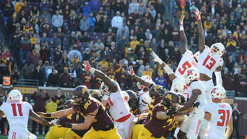 Senior wide receiver Carlton Agudosi and junior defensive end Kemoko Turay leap but fail to block what turned out to be the game-winning field goal from Emmit Carpenter in the dying seconds of Minnesota's 34-32 win over Rutgers Saturday at TCF Bank Stadium in Minneapolis, Minnesota. – Photo by Dimitri Rodriguez