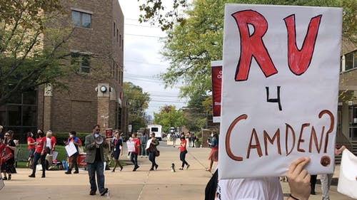 Before the Rutgers Board of Governors meeting, Rutgers community members attended a speakout in front of the meeting's location to protest the University's actions around pay equity and intercampus disparities. – Photo by Courtesy of Alan Maass
