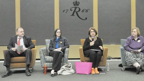 """Staff members from Rutgers Student Life and the Office of Violence Prevention and Victim Assistance, among other offices, sit to discuss the state of sexual violence at the town hall meeting titled """"RU Talking About Sexual Violence?"""" in the Multipurpose Room Wednesday evening at the Busch Campus Center."""