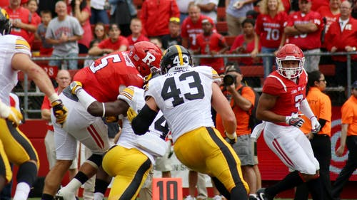 Junior quarterback Chris Laviano is tackled by the final Iowa defender with redshirt freshman Jawuan Harris by his side in the second quarter of Rutgers' 14-7 loss to Iowa Saturday. Laviano elected to run the ball himself rather than pitching it to Harris on 4th-and-2 near the goalline. – Photo by Dimitri Rodriguez