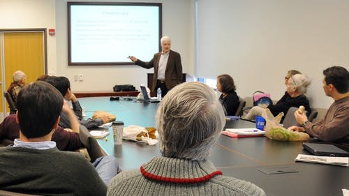 """Duke University professor Philip Cook discusses the benefits of """"smart guns"""" yesterday at the Institute for Health, Healthcare Policy and Aging Research. – Photo by Ruoxuan Yang"""