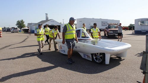 The Rutgers solar race car team received a vehicle from a team at Stanford University. Three club members traveled to California to pick up the solar-powered car to bring to New Jersey. They brought it back in a U-Haul, which saved costs.