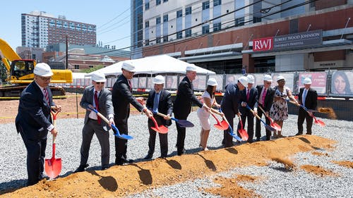 Rutgers officials and New Jersey leaders attended Thursday's ceremonial groundbreaking for the Jack and Sheryl Morris Cancer Center, which will function as a hospital and research facility. – Photo by Daniel DellaPiazza / Rutgers University
