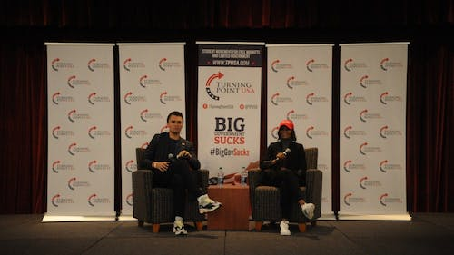 "Charlie Kirk and Candace Owens spoke at a ""Campus Clash"" event Monday night in Trayes Hall at the Douglass Student Center. They discussed the conservative movement on college campuses."