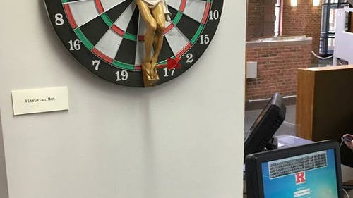 A dartboard with Jesus Christ in a crucified pose was taken down from the Art Library on the College Avenue campus on Thursday. – Photo by Photo by Facebook | The Daily Targum