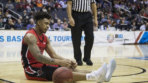 Sophomore guard Corey Sanders sits on the court after turning the ball over in the first half of Rutgers' loss to Northwestern in the second round of the Big Ten Tournament Thursday night. – Photo by Dimitri Rodriguez